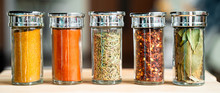 Panoramic View Of Different Kinds Of Spices (Turmeric, Chilli Pepper, Chilli Pepper Powder, Rosemary And Bay Leaf)