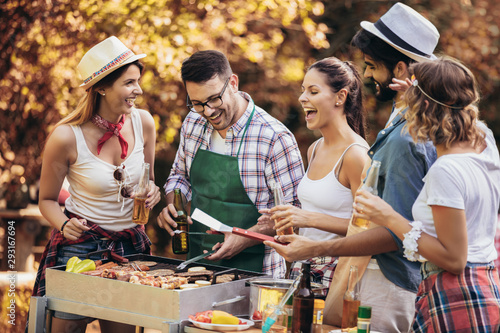 Obraz Happy friends having fun grilling meat enjoying barbecue party - fototapety do salonu