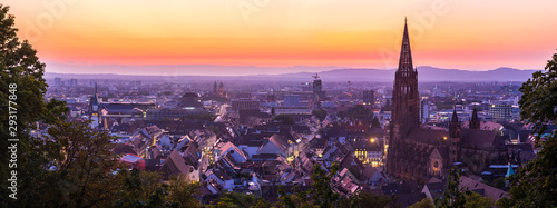 Germany, XXL panorama of skyline of freiburg im breisgau by night after sunset with red sky in magical twilight from above - 293177848