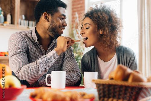 Couple in love having breakfast Canvas Print