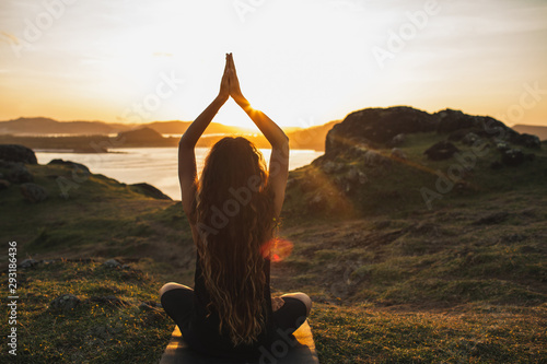 Fotografie, Obraz  Young woman practicing yoga outdoors