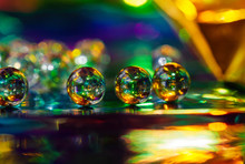 Glass Balls On An Abstract Background