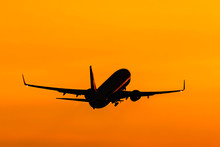 Aircraft Taking Off At Sunset