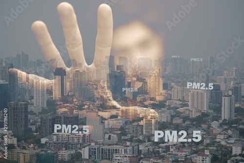 Vászonkép  Double exposure of human hand and blurry face with fog cityscape that have dirty air pm2