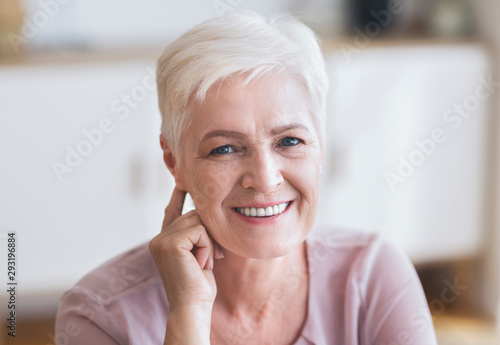 Attractive aged business woman smiling at camera