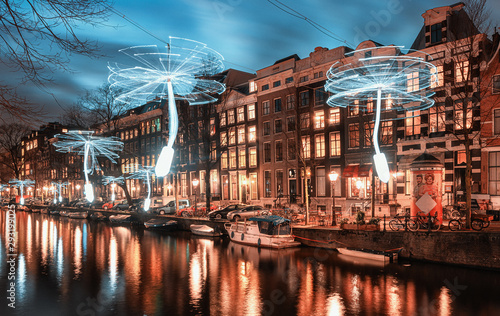 Wind driven propellers in white light above the Herengracht in the old town of A Wallpaper Mural
