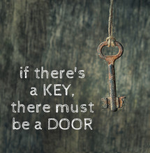 If There's A Key, There Must Be A Door - Inspiration Motivation Quote. Old Retro Rusty Door Key On Wooden Wall Background. Soft Selective Focus.
