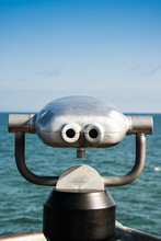 Coin Operated Binoculars Pointing To The Blue Ocean