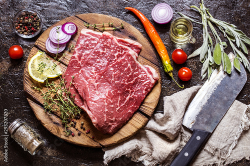meat beef marbled with spices and herbs on a dark background - 293207820