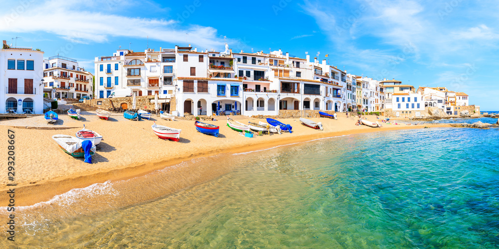 Fototapety, obrazy: Panoramic view of fishing boats on beach in Port Bo with colorful houses of old town of Calella de Palafrugell, Costa Brava, Catalonia, Spain