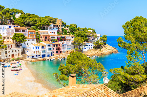 View of beach in Sa Tuna fishing village with colorful houses on shore, Costa Brava, Catalonia, Spain