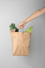 Woman Holding Paper Bag With F...