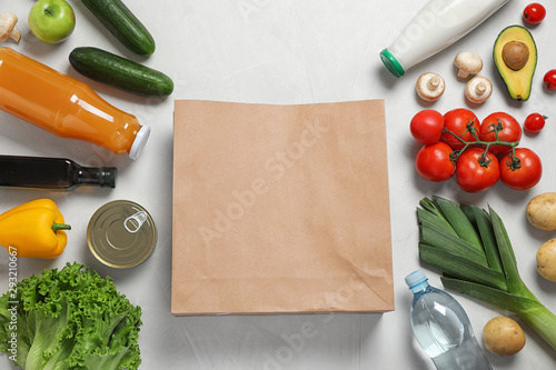 Fresh vegetables and other products on light grey background, flat lay. Space for text