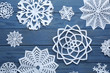 canvas print picture Flat lay composition with paper snowflakes on blue wooden background. Winter season