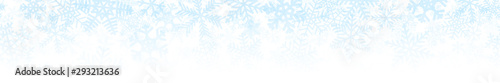Fotografiet  Christmas horizontal seamless banner or background of many layers of snowflakes of different shapes, sizes and transparency