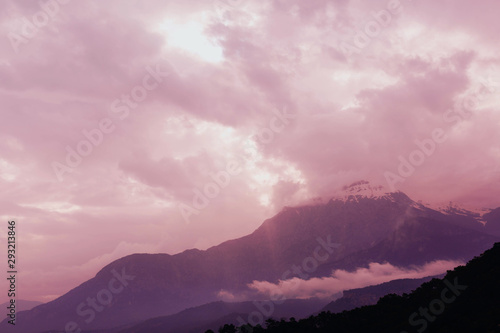 Aluminium Prints Light pink The outlines of mountains and hills through the evening atmospheric fog. A picturesque place for trekking. Fantasy postcard.