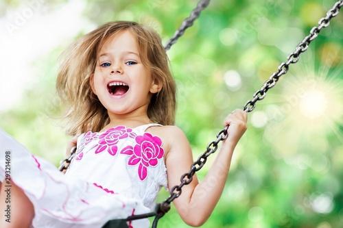 Obraz Little child blond girl having fun - fototapety do salonu