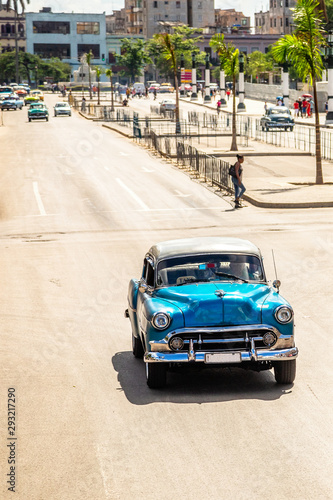Old vintage blue retro car on the road in the center of Havana, Cuba Wallpaper Mural