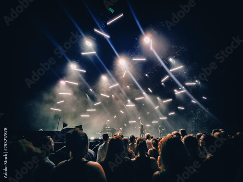Stampa su Tela Concert show background with crowd silhouettes listening to acoustic guitar music live performance by rock band on stage