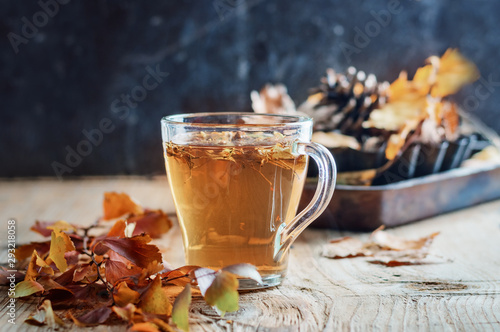 Tea with spices on a wooden background, rustic style, autumn postcard
