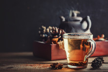 Black Tea In Glass Cup On Wood...