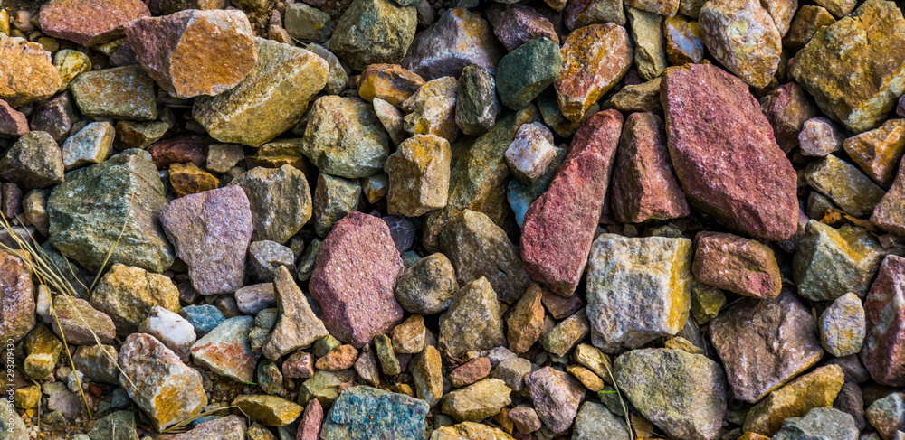 gravel stones in diverse colors in closeup, stone pattern background