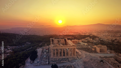 Poster Jaune de seuffre Aerial photo of iconic Masterpiece of Ancient world, Acropolis and the Parthenon at sunset with beautiful golden colours, Athens, Attica, Greece