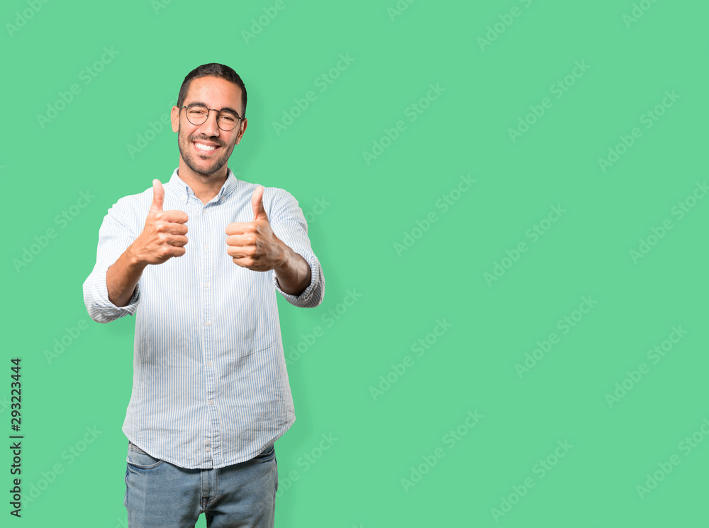 Fototapety, obrazy: Happy young man gesturing that everything is fine