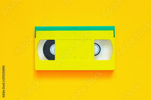 Fotografering Video tape on colored background, VHS, cassette