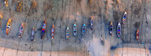 Aerial View Of Fishing Boats At Low Tide