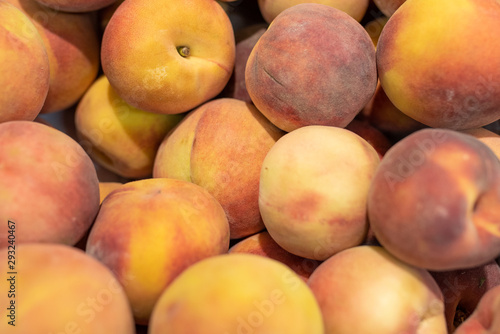 Fresh peaches in a supermarket, background texture.