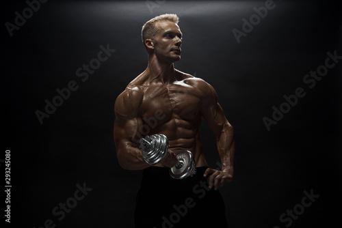 Cuadros en Lienzo Fitness model man posing in studio