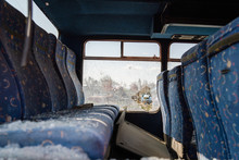 Interior Seats With Broken Windows Of The Wrecked Bus Car Accident Collision Traffic After The Hooligan Vandalism Terrorist Attack