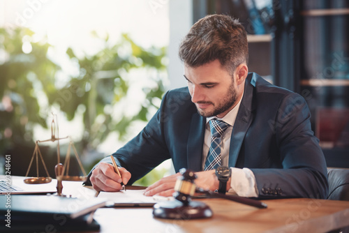 Tableau sur Toile Lawyer or attorney working in the office