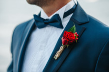 Hands Of Wedding Groom In A White Shirt Dress Cufflinks. Boutonnière. Groom Buttoning The Front Of His Jacket
