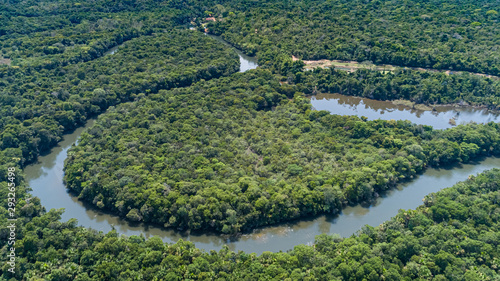 Valokuvatapetti Aerial view of a meandering Amazon tributary river, Amazonian rainforest, San Jo