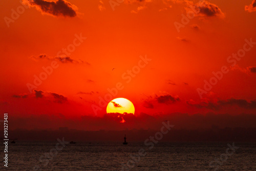 Foto auf AluDibond Rot Romantic Natural Sunset Sunrise Over Field Or Meadow. Bright Dramatic Sky And Dark Ground. Countryside Landscape Under Scenic Colorful Sky At Sunset Dawn Sunrise. Sun Over Skyline, Horizon