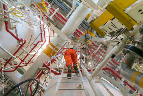 Carta da parati Production operator working at offshore oil and gas central processing platform for inspect and observe gas treatment process
