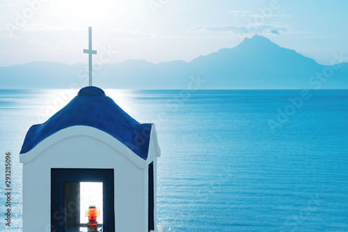 Obraz na plátně  Mount Athos in Greece on a sunny day in summer against a blue sky and the tower of the Orthodox Church