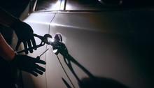 Car Thief Using A Tool To Brea...