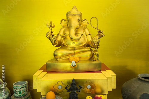 Golden statue of the god Ganesh from Hinduism seated.