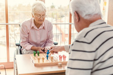 Two Seniors In A Nursing Home Playing A Board Game
