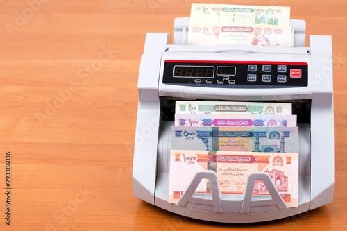 Afghan afghani in a counting machine Canvas Print
