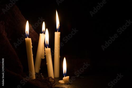 Burning candles on dark background Canvas Print