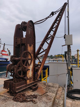 Old Crane In The Seaport In City Brindisi
