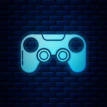 Glowing Neon Gamepad Icon Isolated On Brick Wall Background. Game Controller. Vector Illustration