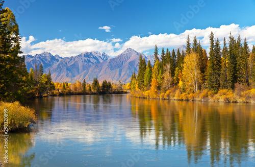 Papiers peints Rivière de la forêt Siberian autumn beautiful landscape with the Eastern Sayan Mountains. Yellowed trees are reflected in the Irkut River. Baikal region, Buryatia, Tunka Valley