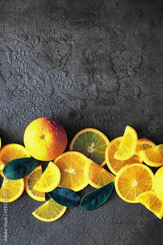 Orange citrus fruit on a stone table. Orange background. - 293322401