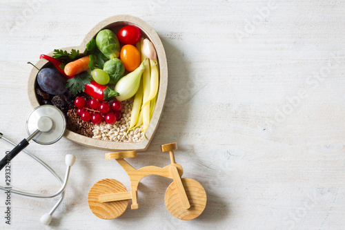 Poster Magasin alimentation Healthy food in heart with stethoscope and bike diet sport lifestyle concept
