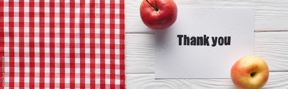 Fototapety, obrazy: top view of ripe apples and thank you card on wooden white table with checkered napkin, panoramic shot